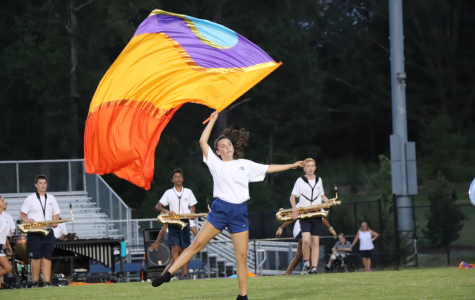 A member of the GL Color Guard performs with the band.