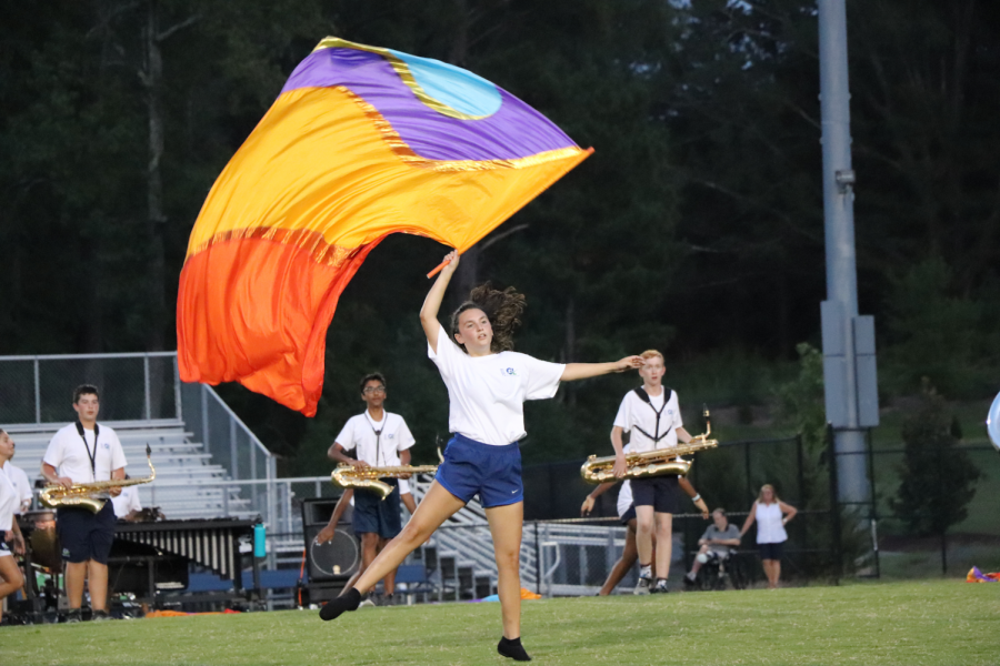 A+member+of+the+GL+Color+Guard+performs+with+the+band.