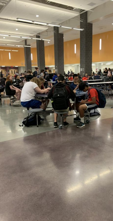 Gators sitting in the cafeteria enjoying their lunch.
