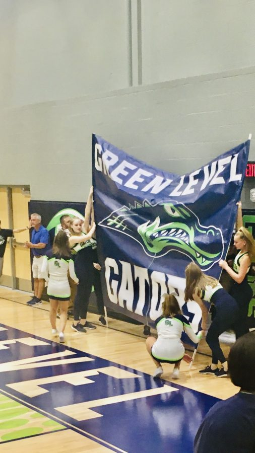Green+Level+Football+about+to+tear+through+the+Green+Level+Gator+sign+being+held+by+the+Cheer+and+Dance+teams.
