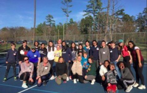 Green Level's Women's Tennis starts volunteering at an Abilities Tennis program.