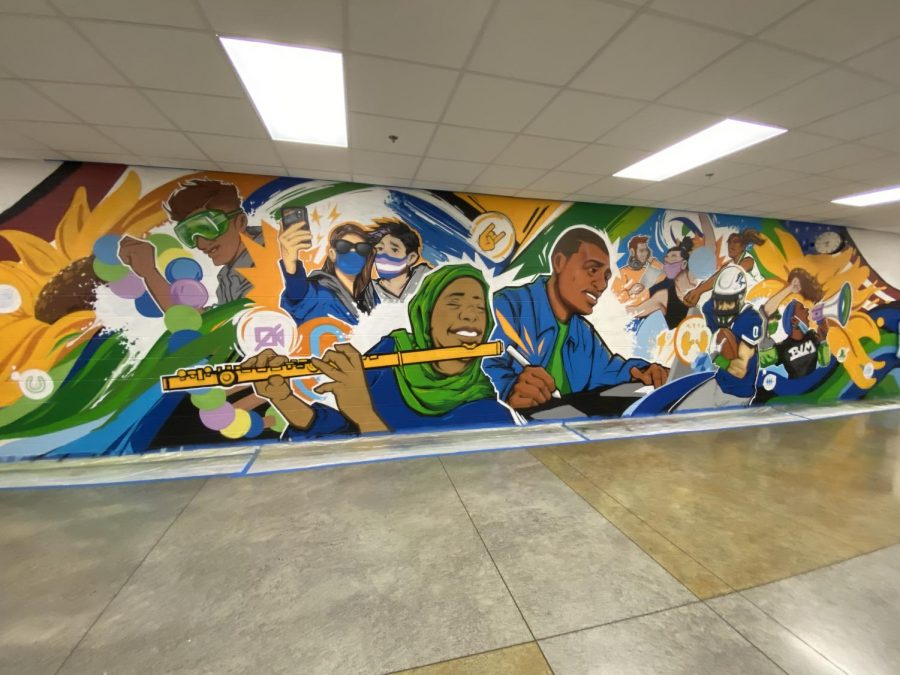 The completed mural reflects the diversity of the school and the events we are experiencing now.