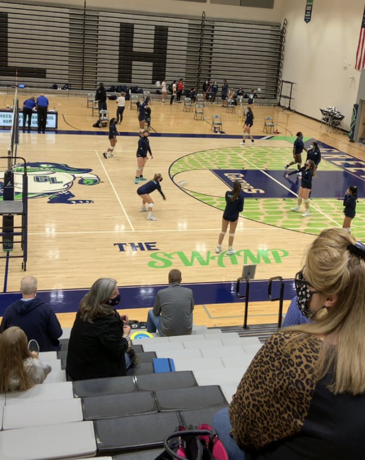 Green Level Volleyball warming up for Riverside game.