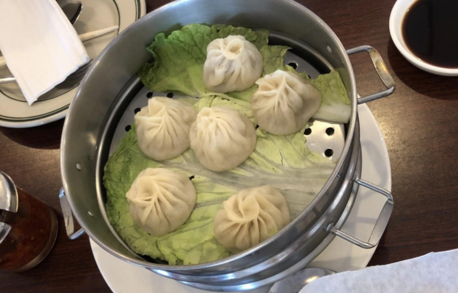 Steamed Soup Dumplings Nestled On Cabbage