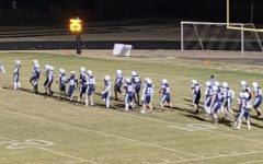 The Varsity Football Team prepares for first home game in school history.