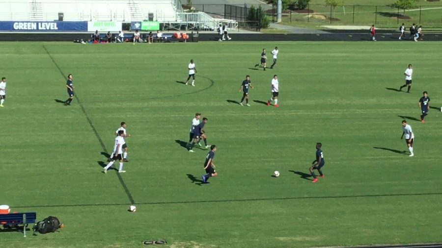 The JV soccer team playing in a match. Via: Corine Geist YouTube