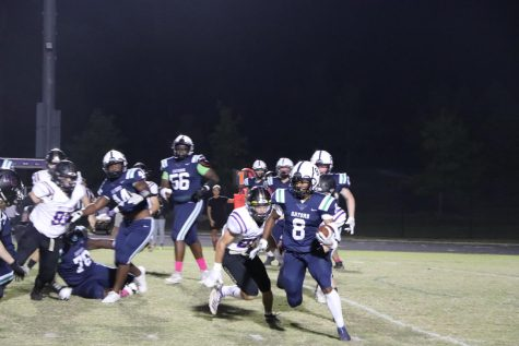 Cam Chatmon wards off a defender to get a first down